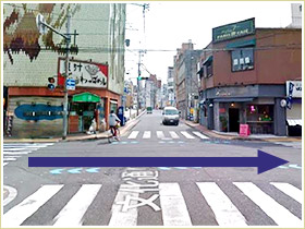 Turn right at the intersection with the traffic light at the end of Bunka-dori